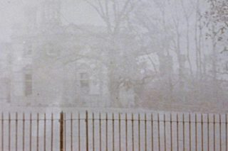 This rather spooky photo shows a large house beyond the railings