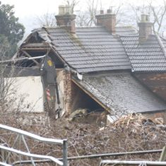 Cottages during demolition - the light coloured square chimney pots are Georgian