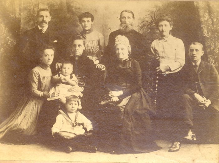 Edith with Family ( Edith kneeling left of photograph) | Family Photograph