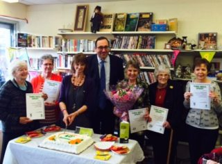 Cutting the Oxfam cake | Beverley Small