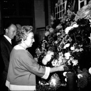 Irene Pond and Ros Kemp with the large floral exhibit placed at the top of the Society's entry | © Watford Observer 1961