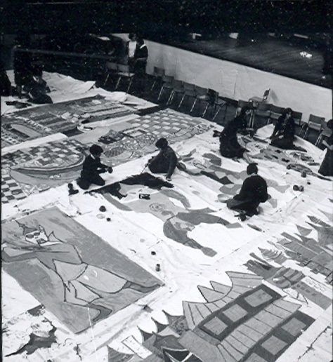Children painting a mural at Clarendon School.  The mural appears to have a far Eastern theme. | © Watford Observer 1963